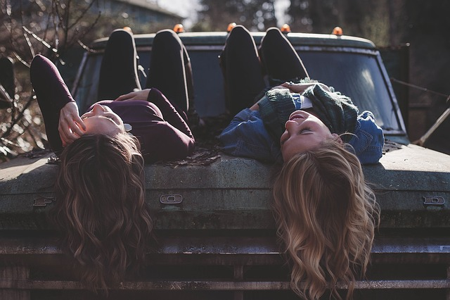 friends relaxing on a truck