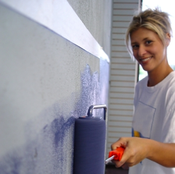 homeowner painting walls